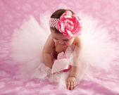 Cute baby girl wearing frilly tutu and headband — Stock Photo