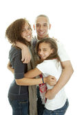 Brother and two sisters hug each other — Stock Photo
