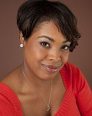 Portrait of smiling pretty black woman — Stock Photo
