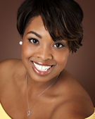 Beautiful black woman with a big toothy smile — Stock Photo