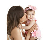 Woman kissing her baby daughter — Stock Photo