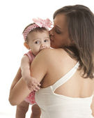 Mother hugging her teething baby daughter — Stock Photo
