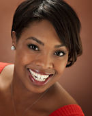 Portrait of young smiling black woman — Stock Photo