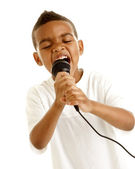 Little boy sings with microphone — Stock Photo