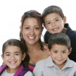 Hispanic single parent family with mother, sons and daughter — Stock Photo #21365487