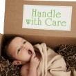Delivery package containing newborn baby — Stok fotoğraf
