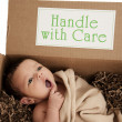 Delivery package containing newborn baby — ストック写真