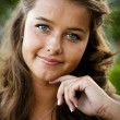 Portrait of smiling teenage girl with beautiful suntan — Stockfoto #21360343