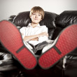 Preteen boy with big feet relaxing — Stock Photo