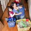 Hispanic family recycling together — Stock Photo #21360565