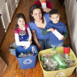 Hispanic family recycling together — Stock Photo