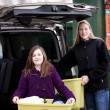 Mother and daughter recycling trash at recycling center - Foto de Stock