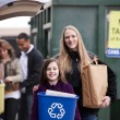 Foto Stock: Mother and daughter recycle trash at recycling сenter