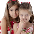 Adorable sisters sitting close together - Foto Stock
