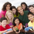 Cute ethnically diverse children working together — Stok Fotoğraf #21360981