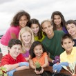 Smiling ethnically diverse children working together — Foto de stock #21360985