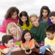 Ethnically diverse children working together  — Stock Photo