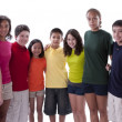 Smiling children of different ethnicities posing in colorful shirts — Stock Photo