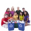 Foto Stock: Diverse preteens of mixed ethnicity working together to recycle