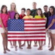 Children of different ethnicities holding an american flag - Stock Photo
