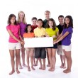 Smiling children and teens holding blank sign - Stock Photo