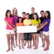 Smiling children and teens holding blank sign — Stock Photo