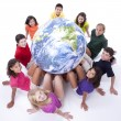 Stock Photo: Interracial group of preteens supporting the earth