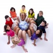 Foto Stock: Children of different ethnicities with feet together