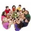 Stock Photo: Diverse group of preteens sitting in circle and holding plants