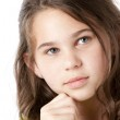 Cute girl with a thoughtful expression on her face — Stock Photo #21361319