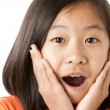 Pretty asian girl is happily surprised — Stock Photo #21361365