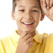 Cute hispanic boy is thinking — Stock Photo #21362025