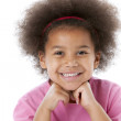 African american little girl has a big smile on her face — Stock Photo
