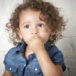 Mixed race toddler girl with a timid expression — Stock Photo #21363203