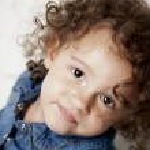 Smiling mixed race toddler girl — Stock Photo