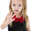 Caucasian little girl holding hand up wave stop - Stock Photo