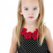 Caucasian little girl with sad expxression on her face — Stock Photo