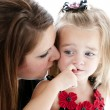 Young mother comforting her daughter — Stock Photo #21363875