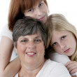Headshot of smiling mother and her two daughters — Stock Photo
