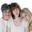 Image of smiling mother and two daughters — Stock Photo #21364381