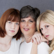 Portrait of caucasian mother and her two daughters — Stock Photo #21364421