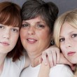 Smiling caucasian mother and her two daughters — Stockfoto