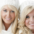 Image of two young smiling women in winter hats — Stock Photo