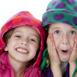 Stock Photo: Two cute little sisters wearing winter hats