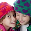 Two cute little sisters wearing winter hats — Stock Photo