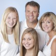 Stock Photo: Headshot of smiling family of four with mother, father and two daughters