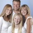 Image of smiling family of four with mother, father and two daughters — Stockfoto