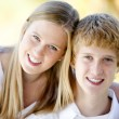 Portrait of a smiling caucasian brother and sister — Stock Photo