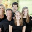 Family of five with mother and father with three teenage children — Stock Photo