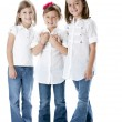 Full length image of three smiling little girls holding hands — Stock Photo